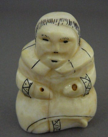 Vintage ivory figure with scrimshaw