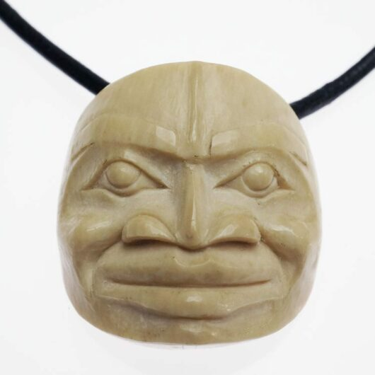 Tom Eneas: moon face pendant carved from mastodon ivory