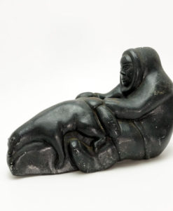 Inuit sculpture man with bear