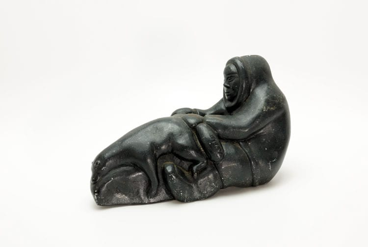 Inuit sculpture man with bear