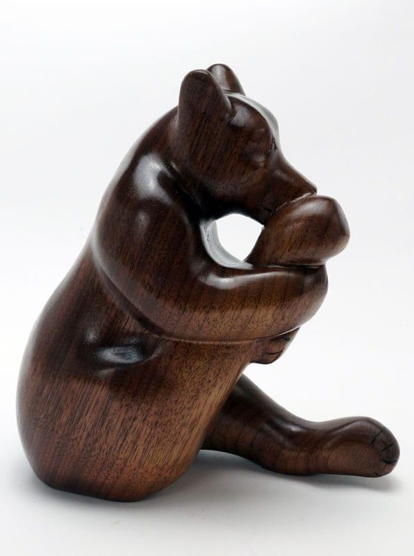 Robbie Craig Wood Bear Licking Foot