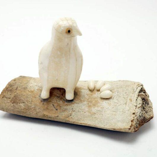Vintage owl on bone nest
