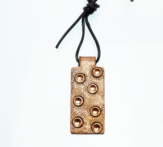 JJ Otero stamped copper tranquility pendant